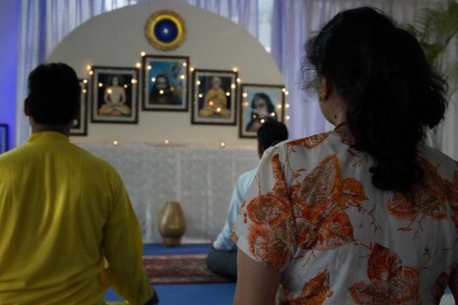 Group Meditating at Altar